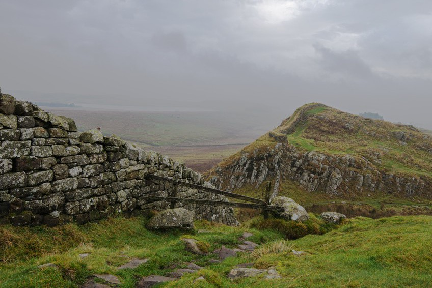 Hadrians Wall looking east towards Broomie Lough from Hotbank Crags on a misty morning.